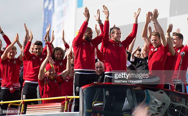 Wales players arrive at the Cardiff City Stadium on an open top bus on July 8 2016 in Cardiff Wales The players toured the streets of Cardiff in an...