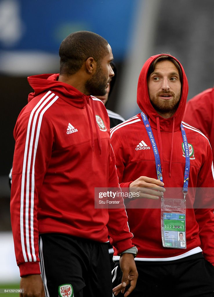 Wales players Ashley Williams (l) and Joe Alen have a chat as they walk round the pitch during Wales training ahead of their Euro 2016 game against Russia at Stadium Muncipal on June 19, 2016 in Toulouse, France.