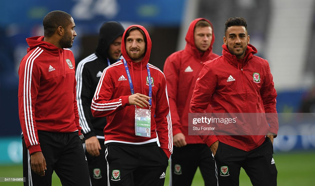 Wales players Ashley Williams (l) Joe Alen (c) and Neil Taylor have a chat as they walk round the pitch during Wales training ahead of their Euro 2016 game against Russia at Stadium Muncipal on June 19, 2016 in Toulouse, France.
