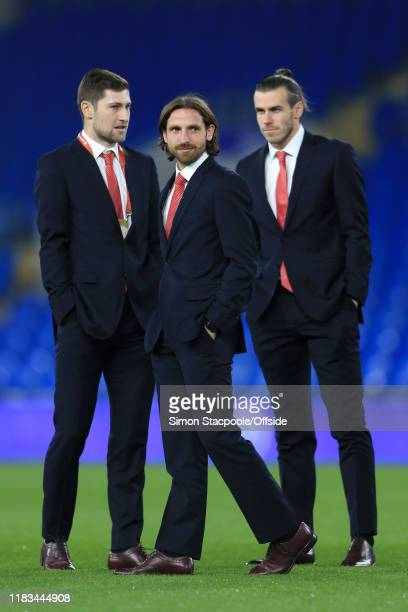 Wales players Ben Davies Joe Allen and Gareth Bale inspect the pitch before the UEFA Euro 2020 Qualifier between Wales and Hungary at Cardiff City...