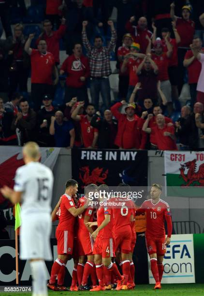 Wales' players celebrate a goal scored by midfielder Tom Lawrence during the FIFA World Cup 2018 qualification football match between Georgia and...