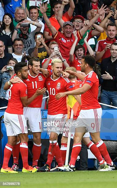 Wales' players celebrate after Northern Ireland scored an own goal during the Euro 2016 round of sixteen football match Wales vs Northern Ireland, on...