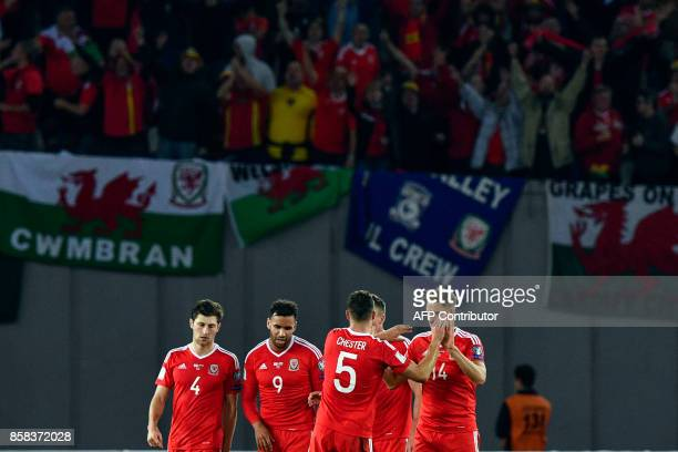 Wales' players celebrate after the FIFA World Cup 2018 qualification football match between Georgia and Wales in Tbilisi on October 6 2017 / AFP...