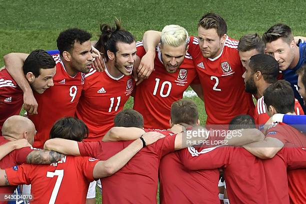 Wales' players celebrate after their team won 1-0 following the Euro 2016 round of sixteen football match Wales vs Northern Ireland, on June 25, 2016...