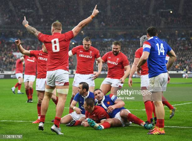 Wales players celebrate as Liam Williams of Wales crosses to score but the try is disallowed during the Guinness Six Nations match between France and...