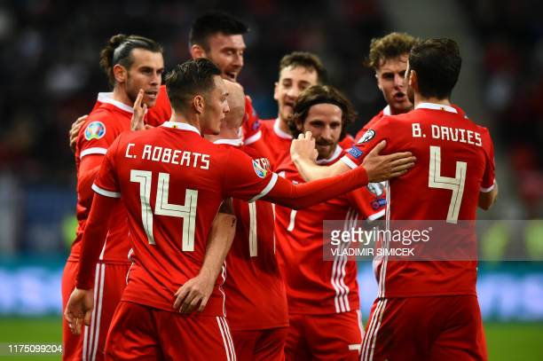Wales' players celebrate scoring the opening goal during the UEFA Euro 2020 Group E qualification football match Slovakia v Wales in Trnava Slovakia...
