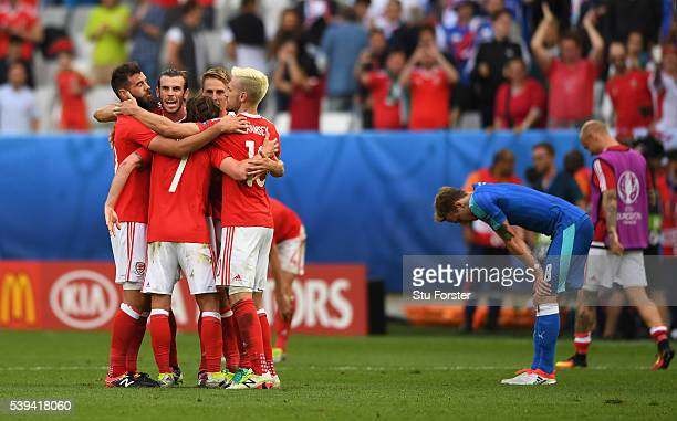 Wales players celebrate their 2-1 win in the UEFA EURO 2016 Group B match between Wales and Slovakia at Stade Matmut Atlantique on June 11, 2016 in...