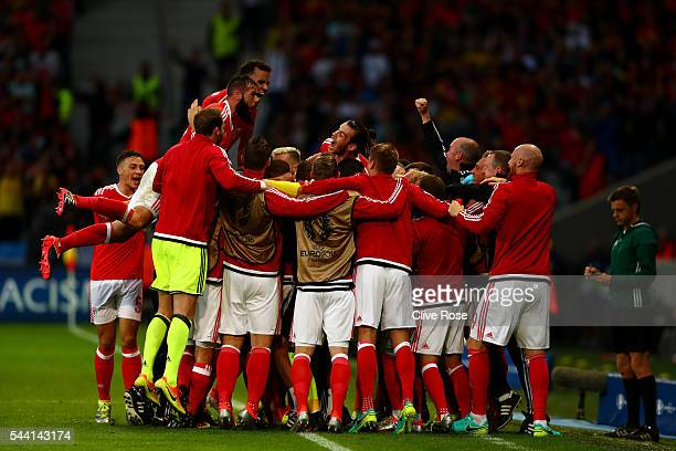 Wales players celebrate their team's first goal by Ashley Williams during the UEFA EURO 2016 quarter final match between Wales and Belgium at Stade...
