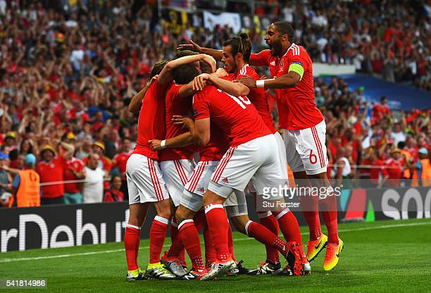 Wales players celebrate their team's first goal scored by Aaron Ramsey during the UEFA EURO 2016 Group B match between Russia and Wales at Stadium...