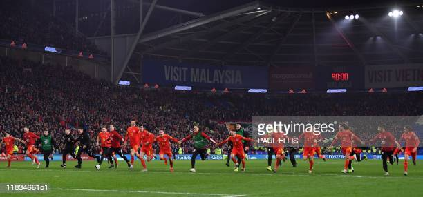 Wales' players celebrate victory and qualification after the Group E Euro 2020 football qualification match between Wales and HUngary at Cardiff City...