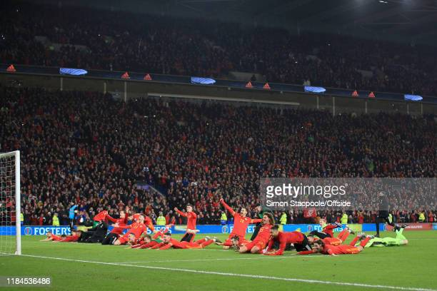 Wales players celebrate victory and qualification after the UEFA Euro 2020 Qualifier between Wales and Hungary at Cardiff City Stadium on November...