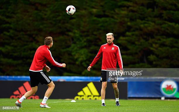 Wales players Chris Gunter and Aaron Ramsey in action during Wales training ahead of their UEFA Euro 2016 Semi final against Portugal at College Le...