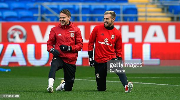 Wales players Chris Gunter and Aaron Ramsey share a joke during Wales training prior to the FIFA 2018 World Cp qualifier against Serbia at Cardiff...
