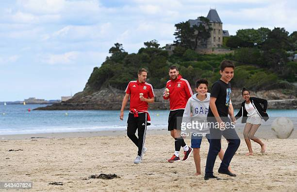 Wales players David Edwards and Sam Vokes enjoy an Ice Cream and a stroll along Dinard beach on June 28, 2016 in Dinard, France.
