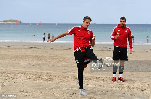Wales players David Edwards and Sam Vokes enjoy an Ice Cream and a kick about on Dinard beach on June 28 2016 in Dinard France