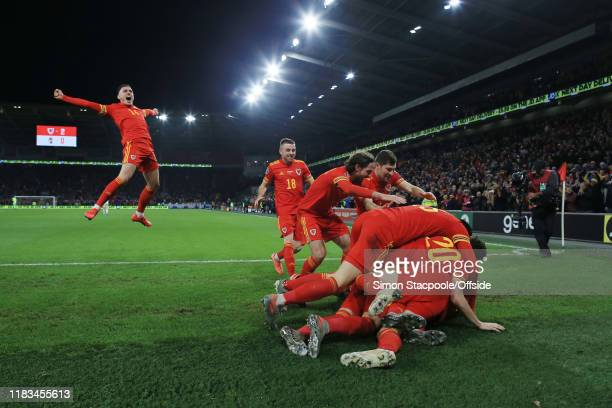 Wales players end up in a heap as they celebrate their 2nd goal during the UEFA Euro 2020 Qualifier between Wales and Hungary at Cardiff City Stadium...