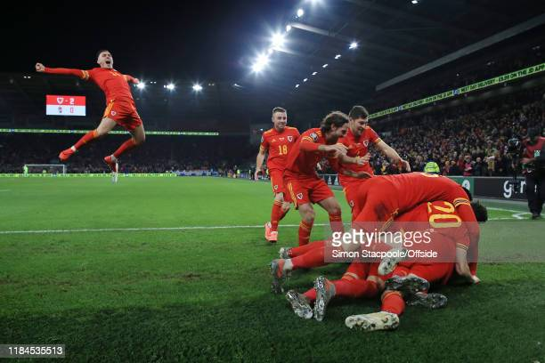 Wales players end up in a heap as they celebrate their 2nd goal, with Connor Roberts of Wales joining in, during the UEFA Euro 2020 Qualifier between...