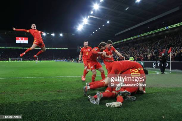 Wales players end up in a heap as they celebrate their 2nd goal with Connor Roberts of Wales joining in during the UEFA Euro 2020 Qualifier between...