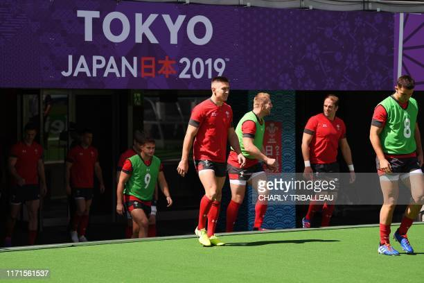Wales' players enter the pitch for a captain run in Tokyo stadium in Tokyo on September 28 during the Japan 2019 Rugby World Cup