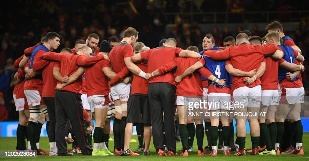 Wales' players form a group huddle on the pitch during warm up ahead of the Six Nations international rugby union match between Wales and France at...