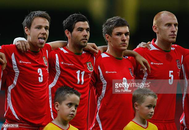 Wales players from left Chris Gunter Joe Ledley Aaron Ramsey and James Collins look on before the FIFA 2010 World Cup Group 4 Qualifier between Wales...
