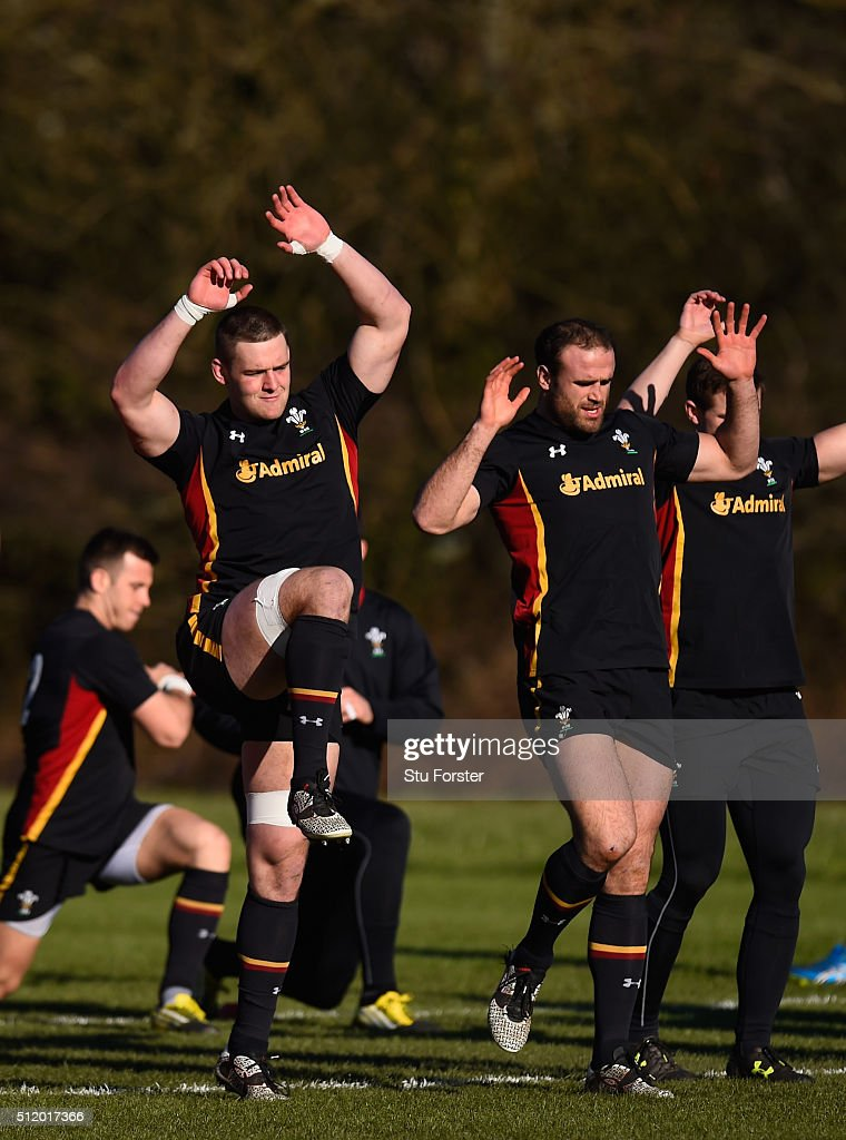Wales players from left to right Dan Lydiate and Jamie Roberts, raise their hands during the warm up during Wales training ahead of their RBS Six Nations match against France, at The Vale Hotel on February 24, 2016 in Cardiff, Wales.