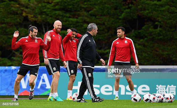 Wales players from left to right Gareth Bale James Collins Neil Taylor and Hal RobsonKanu share a joke during Wales training session ahead of their...