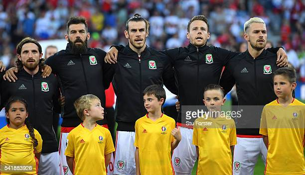 Wales players from left to right Joe Allen Joe Ledley Gareth Bale Chris Gunter Aaron Ramsey with the mascots before the UEFA EURO 2016 Group B match...