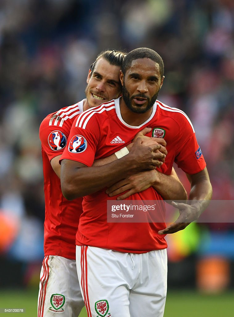 Wales players Gareth Bale (l) and Ashley Williams celebrate after the Round of 16 UEFA Euro 2016 match between Wales and Northern Ireland at Parc des Princes on June 25, 2016 in Paris, France.