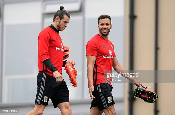 Wales players Gareth Bale and Hal RobsonKanu chat on their way to training ahead of their FIFA World Cup qualifier against Moldova at the Hensol Vale...