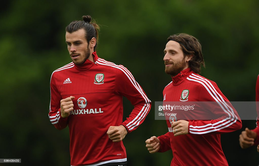 Wales players Gareth Bale (l) and Joe Allen in action during Wales training at the Vale hotel complex on June 1, 2016 in Cardiff, Wales.