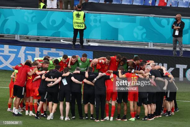 Wales' players gather in a huddle after the UEFA EURO 2020 Group A football match between Italy and Wales at the Olympic Stadium in Rome on June 20,...