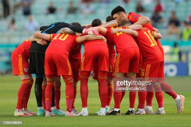 Wales' players gather in a huddle during the UEFA EURO 2020 Group A football match between Wales and Switzerland at the Olympic Stadium in Baku on...