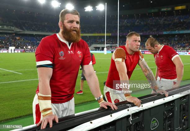 Wales players Jake Ball Ross Moriarty and captain Alun Wyn Jones react dejectedly after the Rugby World Cup 2019 Semi-Final match between Wales and...