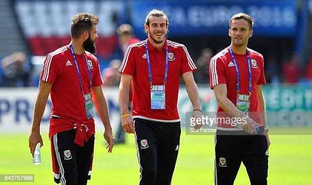 Wales players Joe Ledley Gareth Bale and Andy King share a joke during Wales Open Session prior to their Euro 2016 match against Northern Ireland at...