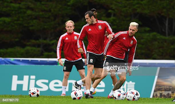 Wales players Jonathan Williams Gareth Bale and Aaron Ramsey in action during Wales training session ahead of their Euro 2016 quarter final match...