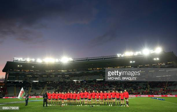 Wales' players line up for the national anthems during the rugby union Test match between Tonga and Wales at Eden Park in Auckland on June 16 2017 /...