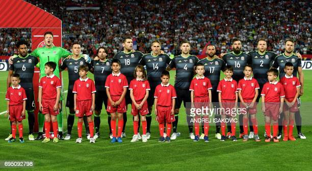 Wales' players listen to the national anthem ahead of the WC 2018 football qualification match between Serbia and Wales in Belgrade on June 11 2017...