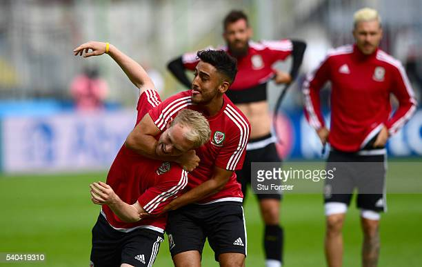Wales players Neil Taylor and Jonathan Williams share a joke during Wales training ahead of their Euro 2016 match against England at Stade...