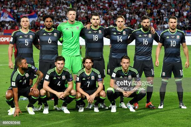 Wales' players pose for a team photo ahead of the WC 2018 football qualification match between Serbia and Wales in Belgrade on June 11 2017 standing...