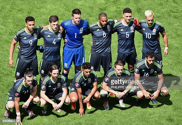 Wales' players pose for a team photo prior to the Euro 2016 group B football match between England and Wales at the BollaertDelelis stadium in Lens...