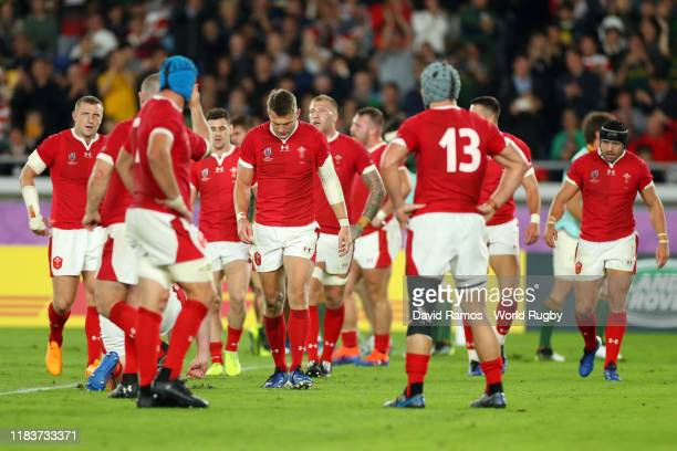 Wales players react after Damian de Allende of South Africa scores his team's first try during the Rugby World Cup 2019 Semi-Final match between...