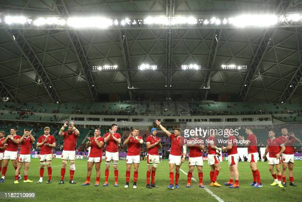 Wales players show appreciation to the fans following the Rugby World Cup 2019 Quarter Final match between Wales and France at Oita Stadium on...