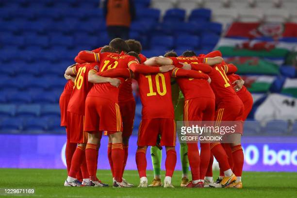 Wales players take a pre-game huddle ahead of the UEFA Nations League group B4 football match between Wales and Finland at The Cardiff City Stadium...