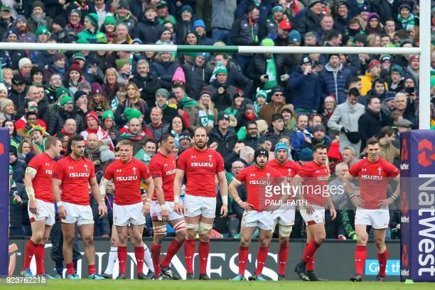 Wales players wait for the last Irish conversion after Ireland's wing Jacob Stockdale scores their late try during the Six Nations international...