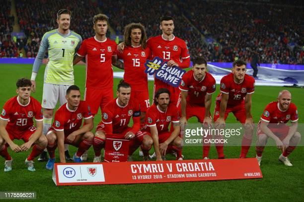 Wales' players Wales' goalkeeper Wayne Hennessey Wales' defender Joe Rodon Wales' defender Ethan Ampadu and Wales' striker Kieffer Moore Wales'...