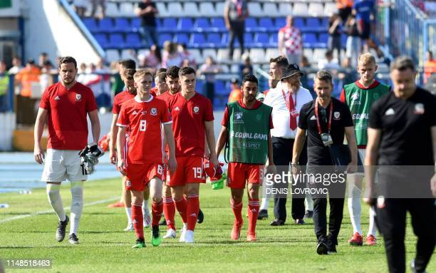 Wales players walk to the dressing room after the Euro 2020 qualification football match between Croatia and Wales at Gradski vrt stadium in Osijek...