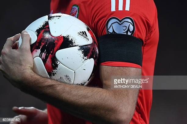 Wales' players wear black armbands during the World Cup 2018 qualification match between Wales and Serbia at Cardiff City stadium in Cardiff on...
