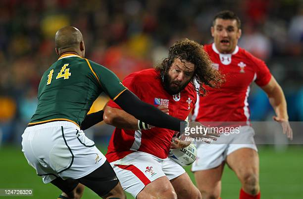 Wales Prop Adam Jones is tackled by Wing JP Pietersen of South Africa during the IRB 2011 Rugby World Cup Pool D match between South Africa and Wales...