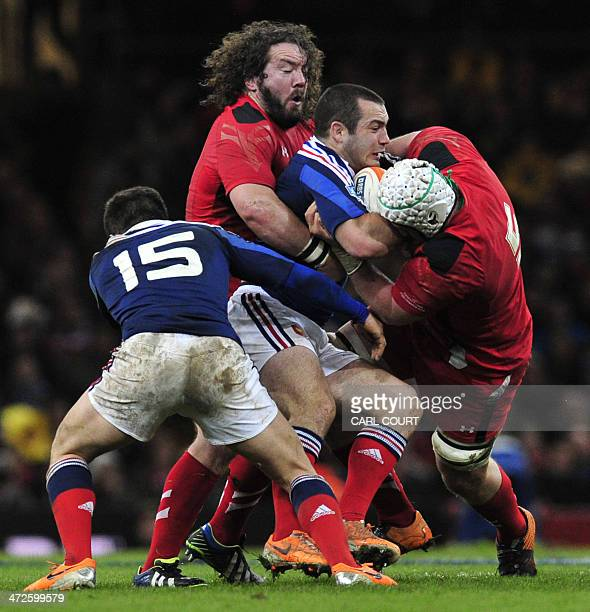 Wales prop Adam Jones tackles France number 8 Louis Picamoles during the Six Nations international rugby union match between Wales and France at the...